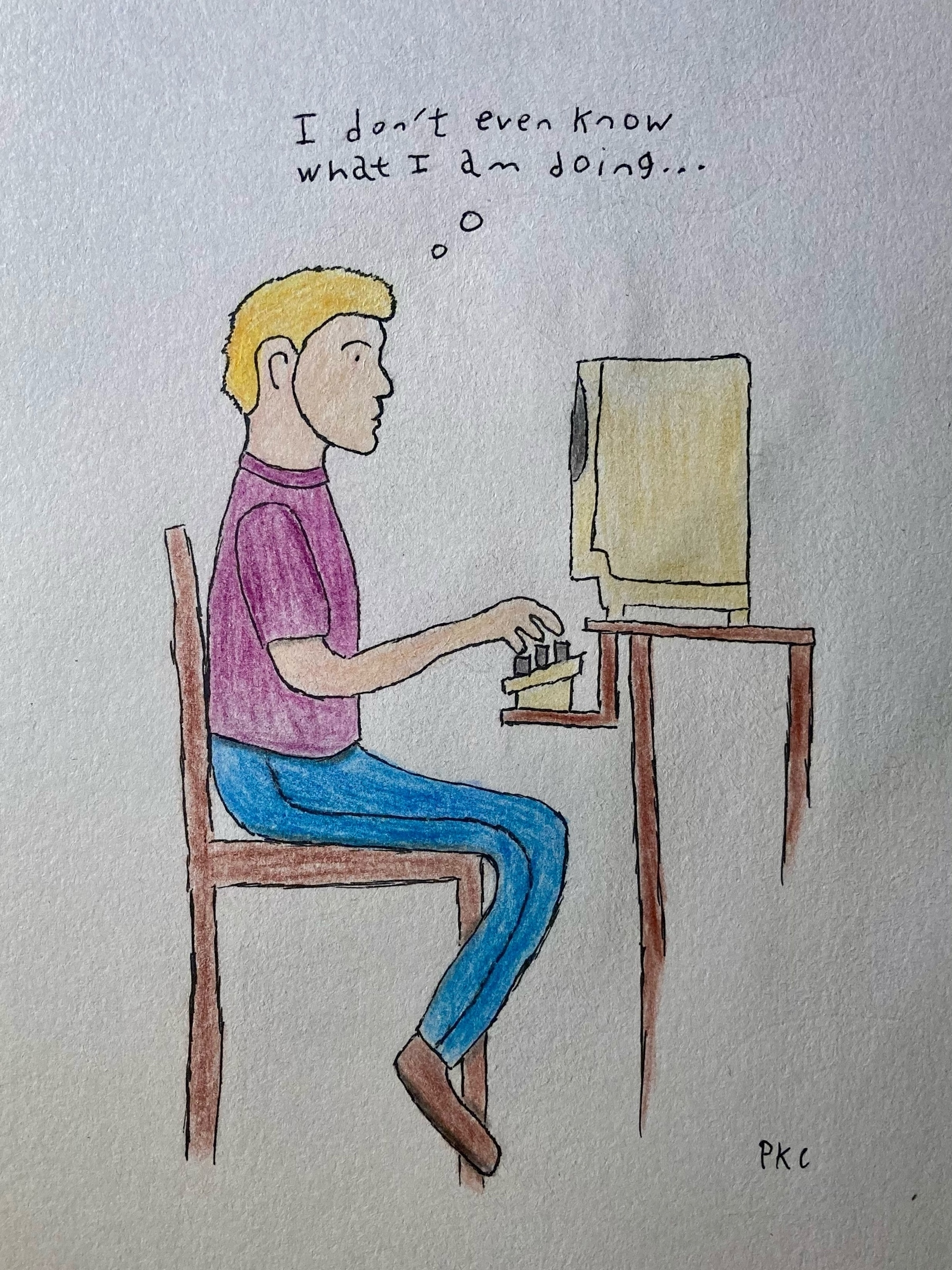 blond man sitting at computer: I don't even know what I am doing